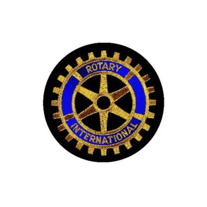 Badge du Rotary brodé à la machine